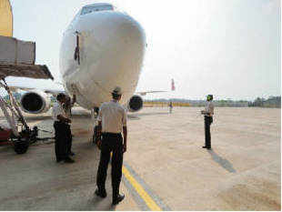DGCA, probing the landing of an Air India flight, has derostered the surface movement controller at the city airport following the preliminary report.