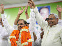 """BJP, which had until now tolerated barbs retaliated by saying the attack would only weaken the fight against a """"non-performing and corrupt UPA"""".  In pic: JD (U) President Sharad Yadav garlanded by Bihar CM Nitish Kumar after being elected president for a third time during its National Executive meet, in New Delhi on Sunday."""