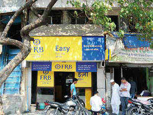 Essentially an investment bank, FirstRand has opened about 13,000 accounts. It has taken Business Correspondent route rather than opening a branch. In pic: FirstRand Bank ATM in Dharavi. The ATM in the slum records about 2,000 transactions a month.
