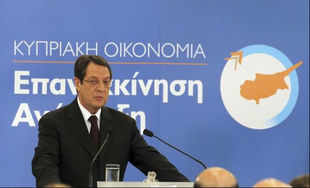Cyprus unveils workfare measures to ease bailout shock