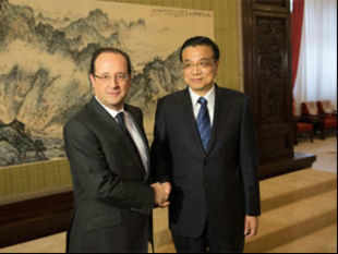 """China is not looking for a trade surplus but wants to import more French goods,"" Li said, according to a source close to the delegations. (Pic by AFP)"