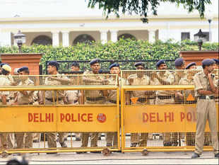 Cops outside PK Bansal's residence in New Delhi on Sunday.