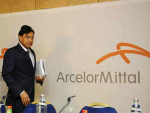 ArcelorMittal reported a net loss of $345 million for the first quarter ended March, but said its restructuring efforts have begun.