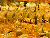 Gold prices declined by Rs 25 to Rs 27,825 per 10 gm today owing to slackened demand at prevailing higher levels amid a weak global trend