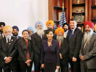 A bipartisan group of 28 Congressmen who joined hands at the Capitol Hill in Washington to establish the first Sikh American Congressional Caucus in the US House of Representatives. (PTI)