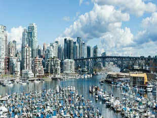 Canada Place is in the heart of Vancouver, so sightseeing is a breeze. Grab a cab, hop on a tour bus or even walk or cycle to the seaside wilderness of Stanley Park, the cobbled streets of historic Gastown or the galleries and shops of Granville Island. In Pic: Downtown Vancouver skyline at Granville Island, Canada.