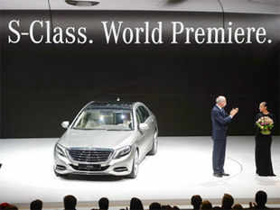 CEO of Daimler AG, Dieter Zetsche presents the new S-Class car from Daimler next to US singer Alicia Keys in the northern German city of Hamburg on May 15, 2013.