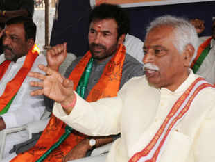 "BJP's National Vice President Bandaru Dattatreya today sought dismissal of CM N Kiran Kumar Reddy for allegedly protecting ""tainted"" ministers."
