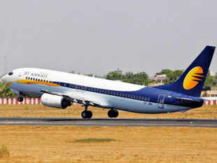 Jet Airways today said its 24% stake sale to the gulf carrier Etihad will bring down its debt to USD 1.5 bn from the current USD 2.1 bn