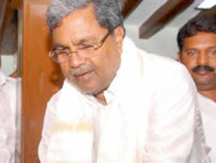 Karnataka Chief Minister Siddaramaiah today expanded his council of ministers by inducting S R Patil, a former leader of opposition.