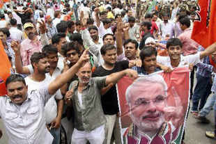 "BJP supporters demonstrate during their day-long shutdown in Bihar called to protest against the alleged ""betrayal"" by the former ally JD-U, in Patna on Tuesday."