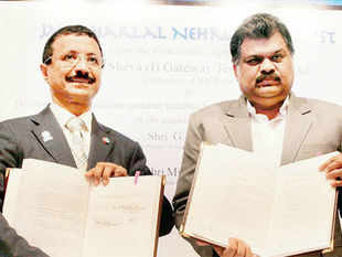 Union shipping minister GK Vasan with DP World chairman Sultan Ahmed Bin Sulayem during signing of concession agreement between Jawaharlal Nehru Port Trust and DP World on Wednesday. PTI