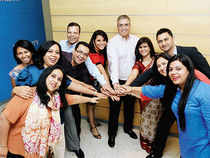 Sanjay Rishi (in white shirt), President, American Express bonds with Jyoti Rai (in saree) and employees at American Express Campus in Gurgaon