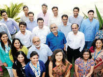 Vijay K Thadani, CEO, NIIT (in deep blue shirt and specs) and Chief People Officer Shampi Venkatesh (leading the group in red saree) pose with fellow NIITians