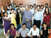 Samit Ghosh (in striped kurta), founder CEO of Ujjivan Financial Services, along with his Head-HRVittal Rangan S (next to him in light blue shirt) and the Ujjivan team at the company's Bangalore headquarters