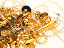 Gold prices today plunged to one- month low by losing Rs 620 to Rs 26,680 per 10 grams on hectic selling by stockists.