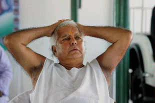 RJD chief Lalu Prasad addressing a press conference on Bagha police firing issue in Patna on Tuesday.Photo