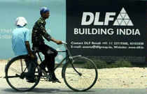 "Competition Commission today directed realty major DLF to ""cease and desist"" from indulging in anti-competitive practices with regard to flats sold in its Belaire project."