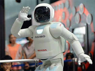 In pic: Humanoid robot Asimo interacts with visitors at the National Museum of Emerging Science and Innovation in Tokyo on July 3, 2013.