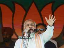Gujarat Chief Minister Narenda Modi is scheduled to meet the Puri Shankaracharya and the Gajapati king during his visit to Odisha on July 16, party sources said.