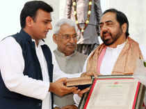 Husain says he had no plans of joining any other political party at this juncture, but would like to concentrate on rehearsing a play.  File photo: Aamir Raza Husain getting Yash Bharati Award during a funtion at Lohia park in Lucknow.