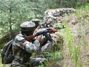 File photo: Army soldiers take position near the site of an encounter with militants at Hafrada forest area of Handwara North Kashmir's frontier Kupwara district.