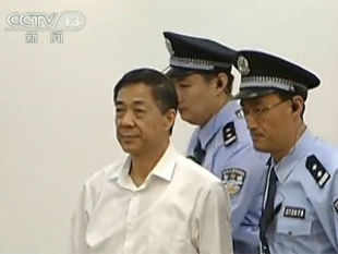 The trial of China's disgraced Communist leader Bo Xilai took an intriguing turn on the first day as he distanced himself from his wife.