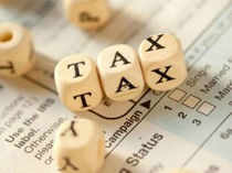 The government has set up a high-level panel under chairmanship of Parthasarathi Shome to review tax laws.