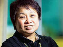 Kim Henares began carrying a gun eight months after becoming the Philippines' chief tax collector. Her shooting instructor was the country's president.