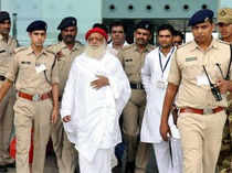 """BSP on Saturday lashed out at delay in the arrest of self-styled Asaram saying that he should have been in jail by now as his act has also """"degraded the Sadhus""""."""