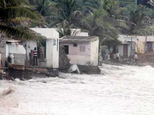 Rough waves hit the fishermen colony Siva Ganeshnagar near Kailasagiri due to the Cyclone Phailin in Visakhapatnam on Saturday.