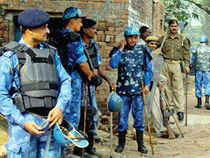 KEEPING VIGIL : Security personnel keeping a watch at Hasanpur village
