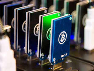 Next month, India's tech capital will demonstrate the country is no bit player when it comes to virtual currency Bitcoins.  In pic: Chain of block erupters used for Bitcoin mining is pictured at the Plug and Play Tech Center in Sunnyvale, California.