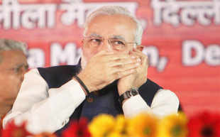 BJP's prime ministerial candidate Narendra Modi brandishes his OBC tag