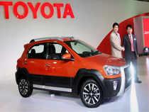 Toyota Kirloskar Motor Managing Director, Naomi Ishii and Toyota Motor Company Chief Engineer Akio Nishimura unveiling the Etios Cross car during the 12th Auto Expo 2014.