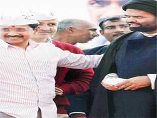 Arvind Kejriwal with a Muslim leader in Kanpur.