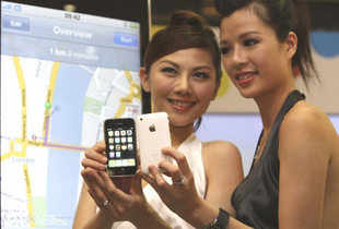 Models hold the new iPhones during release in Hong Kong. (AP)