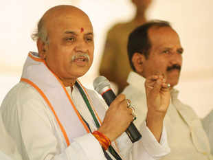Modi is fighting the biggest political battle of his life, it is his former colleague Togadia who is out to make the communal polarisation sharper in his home state.