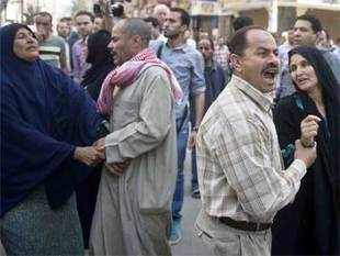 Egyptian relatives reacts outside the courtroom in Egypt's central city of Minya after an Egyptian court sentenced Muslim Brotherhood leader Mohamed Badie and other alleged Islamists to death on Monday.