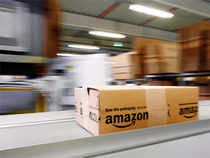 The online retailer is introducing a service that lets Twitter users add Amazon.com products to their carts without leaving the social media site.
