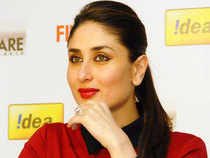Svelte in track pants and a hot pink muscle tee, Kareena lounges feet up on a settee at Saif Ali Khan's and her 10th floor Bandra apartment.