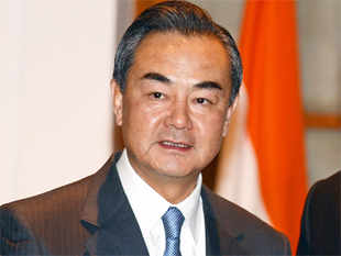 China's foreign minister began a two-day visit to India on Sunday for the first high-level talks between the world's two most populous nations since Prime Minister Narendra Modi took charge.