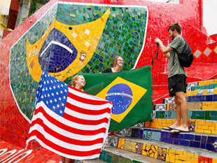 Tourists pose with a U.S. and Brazilian flag ahead of the 2014 World Cup in Rio de Janeiro
