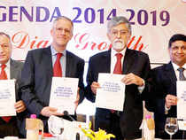 IMF Senior Resident Representative Thomas Richardson, with others, launching a publication at an ASSOCHAM interactive session 'India Agenda 2014-2019 Double Digit Growth' in New Delhi on Wednseday.