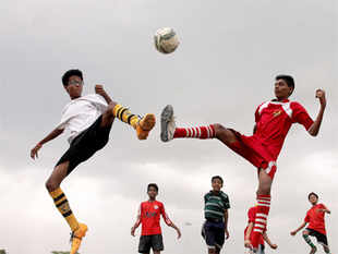 Football fever soars in Indore. Young soccer players vie for the ball during practice sessions at Nehru Stadium in Indore on Wednesday.