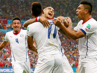 Chile's Mauricio Isla, Eduardo Vargas, Arturo Vidal and Gonzalo Jara celebrate after their first goal during their match against Spain on June 18, 2014.