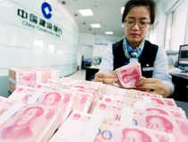 Spot yuan stood at 6.2286 per dollar at midday, up 0.02 per cent from Thursday's close, after the central bank fixed its midpoint at 6.1524, up 0.01 per cent from Thursday.