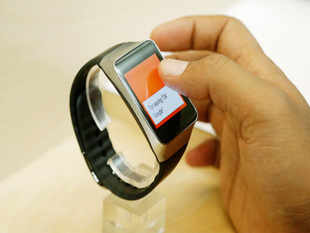 """Samsung's """"Gear Live"""" and LG's """"G Watch"""" are the first devices to adopt the new Google software specifically designed for wearables."""