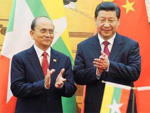 Chinese President Xi Jinping and Myanmar's leader Thein Sein shook hands outside the Great Hall of the People and inspected an honour guard.