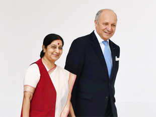 French Foreign Minister Laurent Fabius with External Affairs Minister Sushma Swaraj in New Delhi on June 30.